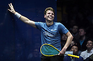 Charles Sharpes of England (in the Green shirt) smiles during his match against Simon Rosner of Germany .Canary Wharf Squash Classic 2016 , day two at the East Wintergarden in Canary Wharf , London on Tuesday 8th March 2016.<br /> pic by John Patrick Fletcher, Andrew Orchard sports photography.