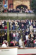 Putney. London.  2004 University Boat Race,  Championships Course, Putney to Mortlake. <br /> <br /> Spectators, waiting for the race to begin, by Putney Bridge.<br /> <br /> [Mandatory Credit Peter SPURRIER]