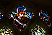 Pre-Raphaelite stained glass window angel by Henry Holiday, c 1860s, Shimpling church, Suffolk, England, UK