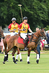 Prince William, Duke of Cambridge, and Prince Harry pictured playing at the Jerudong Trophy polo match, at Cirencester Park Polo Club, Gloucestershire. Picture date: Saturday July 15th, 2017. Photo credit should read: Matt Crossick/ EMPICS Entertainment.