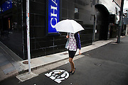 TOKYO, JAPAN, 8 OCTOBER 2012 - Woman with white umbrella in the street  - Shibuya, Aoyama [FR] une femme à l'ombrelle blanche vers Omotesando