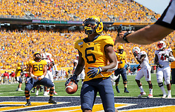 Sep 14, 2019; Morgantown, WV, USA; West Virginia Mountaineers running back Kennedy McKoy (6) runs for a touchdown during the third quarter against the North Carolina State Wolfpack at Mountaineer Field at Milan Puskar Stadium. Mandatory Credit: Ben Queen-USA TODAY Sports