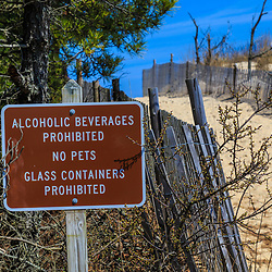 Rehoboth Beach, DE, USA - April 18, 2015: No pets, alcoholic beverages, glass containers at beach sign.