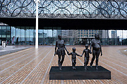 National coronavirus lockdown three begins in Birmingham city centre at Centenary Square, which is deserted near the A Real Birmingham Family sculpture by Gillian Wearing on 6th January 2021 in Birmingham, United Kingdom. Following the recent surge in cases including the new variant of Covid-19, this nationwide lockdown, which is an effective Tier Five, came into operation today, with all citizens to follow the message to stay at home, protect the NHS and save lives.