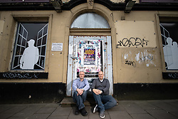 © Licensed to London News Pictures . 18/04/2019. Tameside , UK . LEE STAFFORD (47) and DAVID MCGOVERN (51) of the Stalybridge Town Party , on the step of a derelict pub on the outskirts of Stalybridge Town Centre . Independent political parties , not tied to existing national parties , are competing for council seats in wards across the North West . Photo credit : Joel Goodman/LNP