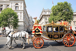 25/05/2010..Queen Elizabeth II passes Downing Street in her ceromonial carriage on her way to open the first coalition parliament since 1974..