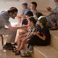 Israel, Golan Heights, School teacher with pupils in classroom on Moshav Qeshet