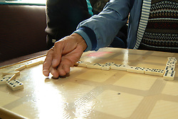 Men play dominoes at the Dominican Association Community Centre, Bradford West Yorkshire UK