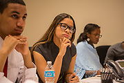 Purchase, NY – 31 October 2014. Early College High School team member Jamely Marte listening to a point. The Business Skills Olympics was founded by the African American Men of Westchester, is sponsored and facilitated by Morgan Stanley, and is open to high school teams in Westchester County.