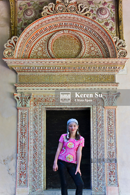Girl at the door of Bakhchisaray Palace in Central Crimea, Ukraine, Europe