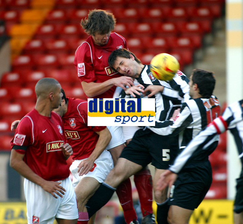 Photo: Dave Linney.<br />Walsall v Rotherham United. Coca Cola League 1.<br />26/11/2005.Ian Roper( Walsall) heads goalwards with the close attention of  Shaun Barker(Rotherham)