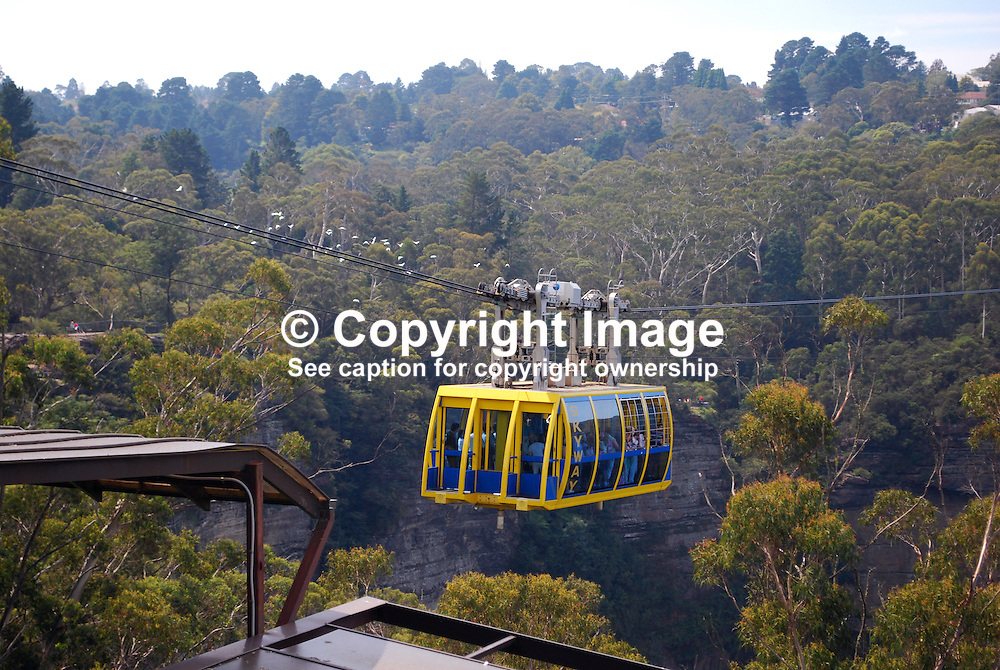 Scenic Skyway, Blue Mountains, New South Wales, Australia, takes you on a 720 metre journey, 270m above ancient ravines and dazzling waterfalls.  You are suspended over Jurassic rainforests as you glide smoothly across the sky. This ride boasts a world first - an Electro-Sceniglass floor.  At the flip of a switch, breathtaking views are revealed through the cabin floor..The 360 degree bird's eye view from the Skyway takes in the Three Sisters, Katoomba Falls, Mount Solitary and the Jamison Valley. 201003273472...Copyright Image from Victor Patterson, 54 Dorchester Park, Belfast, UK, BT9 6RJ..Tel: +44 28 9066 1296.Mob: +44 7802 353836.Voicemail +44 20 8816 7153.Skype: victorpattersonbelfast.Email: victorpatterson@mac.com.Email: victorpatterson@ireland.com (back-up)..IMPORTANT: If you wish to use this image or any other of my images please go to www.victorpatterson.com and click on the Terms & Conditions. Then contact me by email or phone with the reference number(s) of the image(s) concerned.