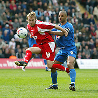 Photo: Chris Ratcliffe.<br />Leyton Orient v Grimsby Town. Coca Cola League 2. 17/04/2006.<br />Paul Connor (L) of Leyton Orient nicks the ball away from Justin Whittle of Grimsby