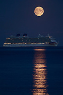 The Harvest Moon rises above P&O Cruises' largest ship, Britannia, at anchor in Weymouth Bay. The cruise industry has suffered a complete shutdown during the covid-19 pandemic and many vessels are currently waiting at various anchorages around the coast of Great Britain and the world.<br /> Picture date Tuesday 1st September, 2020.<br /> Picture by Christopher Ison. Contact +447544 044177 chris@christopherison.com