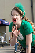 Attractive waitress from the Roller Derby bantering with customers. Grand Old Day Street Fair St Paul Minnesota USA