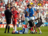 Photo: Ed Godden.<br /> Portsmouth v Liverpool. The Barclays Premiership. 28/04/2007. Pompey's Matthew Taylor receives medical attention. He later left the pitch injured.