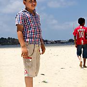 Ashraf waits while his friend Mostafa walks away.