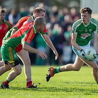Kilrush Shamrock's Stephen Ryan is chased by O'Curry's-Naomh Eoin's Mark McQuaid and Sean Haugh