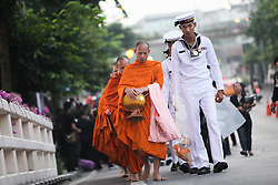 October 13, 2017 - Bangkok, Thailand - Thai people offered food to 209 monks outside the Siriraj Hostipal Bangkok to honour His Majesty the late King Bhumibol Adulyadej. The religious ceremony was held to commemorate the one year anniversary of the late King's passing. (Credit Image: © Panupong Changchai/Pacific Press via ZUMA Wire)