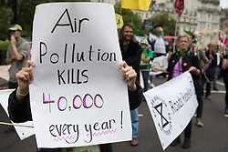 Environmental activists from Extinction Rebellion, Stop HS2, XR Roads Rebellion and Paid to Pollute take part in a Stop The Harm march during the fourth day of Impossible Rebellion protests on 26th August 2021 in London, United Kingdom. Extinction Rebellion are calling on the UK government to cease all new fossil fuel investment with immediate effect.