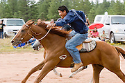 """09 SEPTEMBER 2007 -- ST. MICHAELS, AZ: JONAH BEGAY on Therapist come into the finish line at the end of a two and a half mile long race at a traditional Navajo Horse Race in the summit area of the Navajo Indian reservation about 10 miles west of St. Michaels, AZ. Traditional horse racing is making a comeback on the Navajo reservation. The races are run on improvised courses that vary depending on the local terrain. Use of saddles is optional (except in the """"Cowhand Race"""" which requires a western style saddle) and many jockeys ride bareback. The distances vary from one mile to as long as thirty miles. Traditional horse races were common until the 1950's when they fell out of favor, but there has been a resurgence in traditional racing since the late 1990's and now there is a traditional horse racing circuit on the reservation. The race was organized by the Begay family of Steamboat, AZ and run on private land about three miles from a paved road. Jonah Begay won the race.  PHOTO BY JACK KURTZ"""