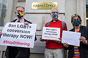 Veteran LGBT+ and human rights campaigner Peter Tatchell l, Revd Colin Coward c and Jayne Ozanne of the Ban Conversion Therapy Coalition r prepare to hand in a petition signed by 7,500 people at the Cabinet Office and Government Equalities Office calling on the government to fulfil a promise it made in July 2018 to ban LGBT+ conversion therapy on 23rd June 2021 in London, United Kingdom. LGBT+ conversion treatments, which have been linked to anxiety, depression and self-harm, have been condemned by major UK medical, psychological and counselling organisations.