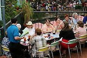 An outdoor restaurant scene on the Riverwalk, San Antonio, Texas. (Supporting image from the project Hungry Planet: What the World Eats.)