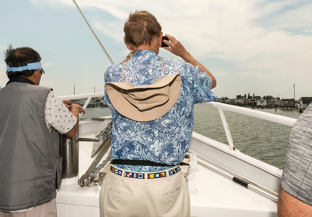August 4, 2017 - Tangier Island, VA - Tourists on the boat the Stephen Thomas survey the approach to Tangier Island, Va. Photo by Susana Raab/Institute