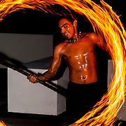 Performer playing with fire. Oasis hotel Riviera Maya.