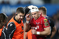 Gareth Davies of the Scarlets gets his head bandaged. Guinness Pro14 rugby match, Ospreys v Scarlets at the Liberty Stadium in Swansea, South Wales on Saturday 7th October 2017.<br /> pic by Andrew Orchard, Andrew Orchard sports photography.