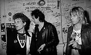 Chris Briggs, Rambo, Mick Jones and Mick Ronson backstage 1977