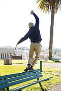 Mature Man balancing on park bench