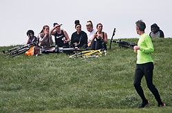 © Licensed to London News Pictures. 13/04/2020. London, UK. A group of women sitting down having lunch on the top of Primrose Hill in London, during a pandemic outbreak of the Coronavirus COVID-19 disease. The public have been told they can only leave their homes when absolutely essential, in an attempt to fight the spread of coronavirus COVID-19 disease. Photo credit: Ben Cawthra/LNP