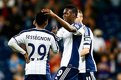 Stephane Sessegnon and Brown Ideye of West Brom celebrate after their side is given a 1-0 lead from an own goal by Johnny Mullins of Oxford United (not pictured) - Photo mandatory by-line: Rogan Thomson/JMP - 07966 386802 - 26/08/2014 - SPORT - FOOTBALL - The Hawthorns, West Bromwich - West Bromwich Albion v Oxford United - Capital One Cup Round 2.