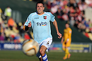 Liam Sercombe of Exeter city in action. Skybet football league two match, Newport county v Exeter city at Rodney Parade in Newport, South Wales on Sunday 16th March 2014.<br /> pic by Andrew Orchard, Andrew Orchard sports photography.