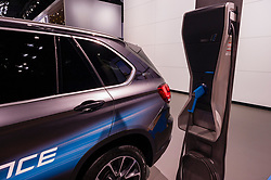 NEW YORK, USA - MARCH 23, 2016: BMW X5 xDrive40e and charging station on display during the New York International Auto Show at the Jacob Javits Center.