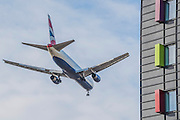 A plane comes in to land past a premier inn near Herathrow.