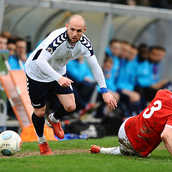 TELFORD COPYRIGHT MIKE SHERIDAN 9/3/2019 - Adam Dawson of AFC Telford hurdles the tackle of Stephen O'Halloran during the National League North fixture between AFC Telford United and FC United of Manchester (FCUM) at the New Bucks Head Stadium