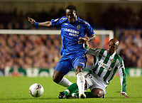 Photo: Daniel Hambury.<br />Chelsea v Real Betis. UEFA Champions League.<br />19/10/2005.<br />Chelsea's Mickael Essien and Betis' Marcos Assuncao battle for the ball. After this challange Essien seemed to fake injury for some minutes.
