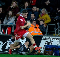 Steff Evans of Scarlets is tackled by Owen Watkin of Ospreys<br /> <br /> Photographer Simon King/Replay Images<br /> <br /> Guinness PRO14 Round 11 - Ospreys v Scarlets - Saturday 22nd December 2018 - Liberty Stadium - Swansea<br /> <br /> World Copyright © Replay Images . All rights reserved. info@replayimages.co.uk - http://replayimages.co.uk