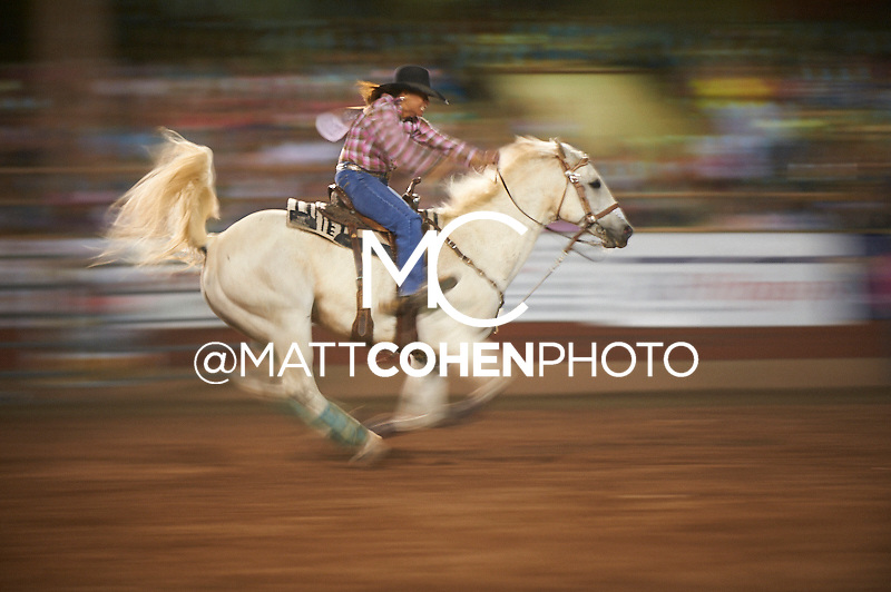 Barrel racer Brenda Sims of Riverton, WY competes at the Pikes Peak or Bust Rodeo in Colorado Springs, CO.<br /> <br /> <br /> UNEDITED LOW-RES PREVIEW<br /> <br /> <br /> File shown may be an unedited low resolution version used as a proof only. All prints are 100% guaranteed for quality. Sizes 8x10+ come with a version for personal social media. I am currently not selling downloads for commercial/brand use.