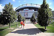 Denver Broncos fans come early as they walk toward the stadium while looking at the exterior facade of Sports Authority Field at Mile High before the Denver Broncos NFL week 1 season opening football game against the Baltimore Ravens on Thursday, Sept. 5, 2013 in Denver. ©Paul Anthony Spinelli