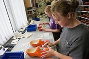 Voor de versiering worden transfers gebruikt. Produktie bij de grootste klompenfabriek ter wereld, Klompenfabriek Nijhuis B.V. in Beltrum. Voor de productie van klompen worden speciale en zelf ontwikkelde machines gebruikt. Hoewel het principe al erg oud is, worden de productietechnieken nog steeds verbeterd.<br /> <br /> Stickers are used for the decoration. Production at the biggest manufacturer of wooden shoes, Klompenfabriek Nijhuis B.V. at Beltrum (NL). For the production special and self developed machines are used. Although the principe of the manufacturing is very old, the techniques are still being improved.