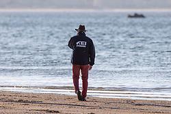 FEI Steward, watching over the beach in La Baule <br /> CSIO La Baule 2021<br /> © Hippo Foto - Dirk Caremans<br />  11/06/2021