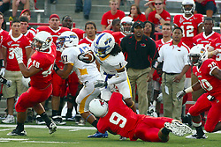 10 September 2011: Jordan Neukirch gets blocked out by Jordan Hendrix as Mike Zimmer gets a hold on ball carrier Donte Sawyer during an NCAA football game between the Morehead State Eagles and the Illinois State Redbirds at Hancock Stadium in Normal Illinois.