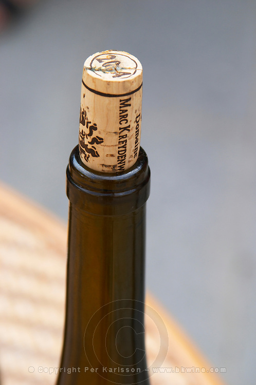 A bottle and a cork stamped with Kreydenweiss Domaine Marc Kreydenweiss, Andlau, Alsace, France