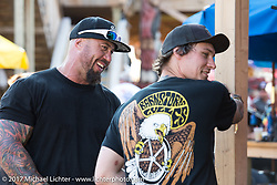 Will Ramsey of Faith Forgotten Choppers (L) and Jake Cutler of Barnstom Cycles at the Iron Horse Saloon during the annual Sturgis Black Hills Motorcycle Rally.  SD, USA. Monday August 7, 2017. Photography ©2017 Michael Lichter.