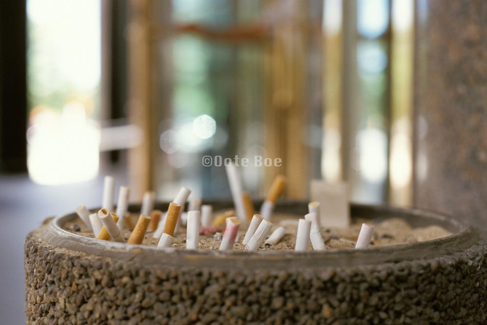 close up of public ashtray