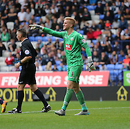 Bolton Wanderers goalkeeper Ben Amos issues instructions during the Sky Bet Championship match between Bolton Wanderers and Brighton and Hove Albion at the Macron Stadium, Bolton, England on 26 September 2015.