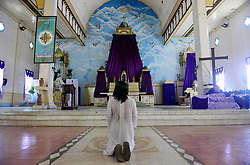April 14, 2017 - Cebu, Philippines - Gilbert Bargayo kneels and prays at the Tuburan Church before being crucified in Tuburan Cebu, in Cebu, on April 14, 2017. Gilbert Bargayo 57 years old makes his 23st crucifixion this Good Friday at Tuburan Cebu City. Mr Bargayo started his crucifixion at the Age of 30 and had the idea when he was 16 years old and was told by Jesus Christ in his dream about his mission. His sacrifice every good friday will help him build a chapel in his hometown. (Credit Image: © Ralph Piezas/NurPhoto via ZUMA Press)